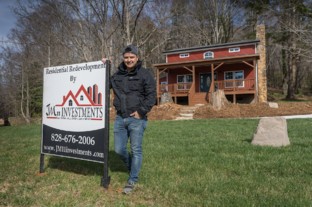 Julian Montoya in front of one of his recently-completed projects.