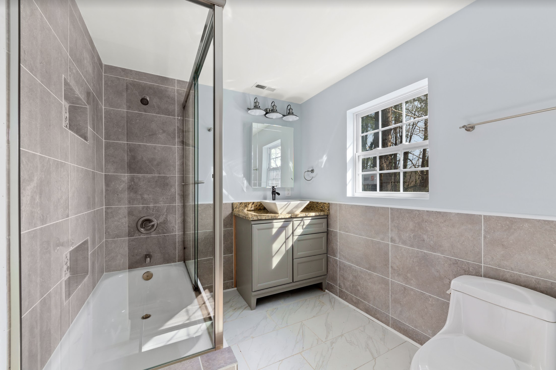 A newly-renovated bathroom in Julian's recently-completed real estate project.